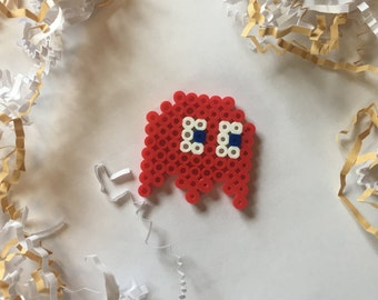 Red Pac-man ghost