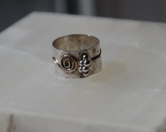 Wide silver hammered band with gold accent