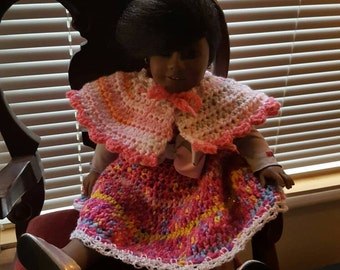 Doll with crochet dress and poncho.  On sale