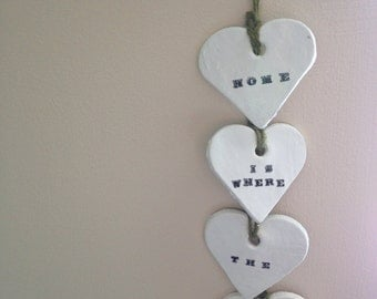 Home is where the heart is... Set of 4 hanging love heart plaques