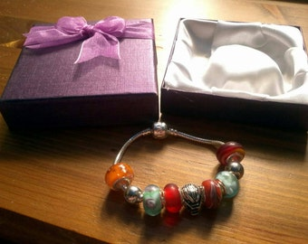 Stunning Warm Poolside Summer charm bracelet with Wolf's Head. Snake Chain with snap closure. Gift boxed.