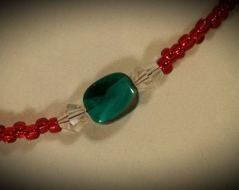 Long Red Beaded Necklace with Swirled  Beads