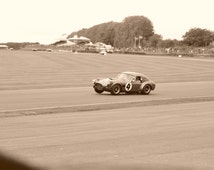 Wall art: Framed photography of an AC Cobra on 3wheels - 30x40cm - Cepia - black frame - Classic car