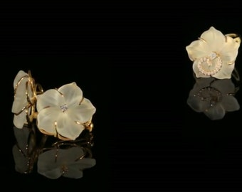 Beautiful 14 k gold earrings diamonds in total 0.82 CT
