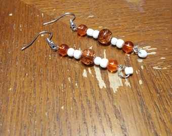 White and orange earrings