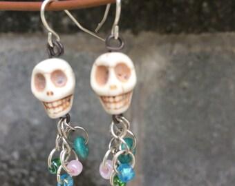 Skull earrings with dangling beads