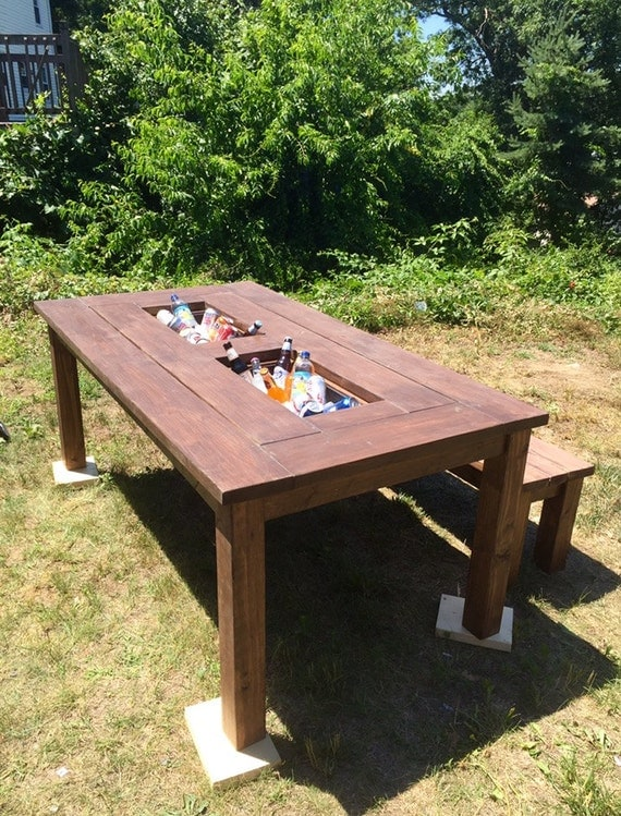 Patio table with built in coolers and matching benches