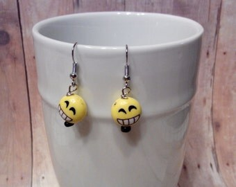 Big toothy smile dangle earrings