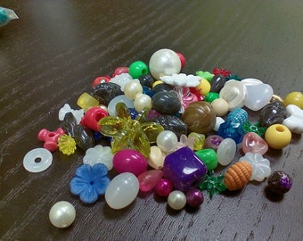 Mixed lot of beads, all shapes and sizes. Every bag is different! (.5 oz)
