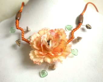 Necklace was orange branch of beaded flowers.