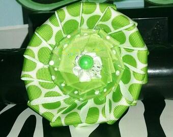 Green polka dot flower hair clip