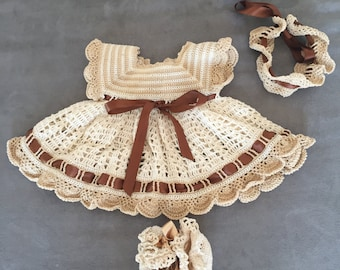 Beautiful dress in beige/Brown/cream crochet headband and matching slippers. Size 1-3 months.