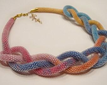 Shiny rainbow beaded necklace transformer (lariat) made of Japanese Toho beads and Swarovski crystals