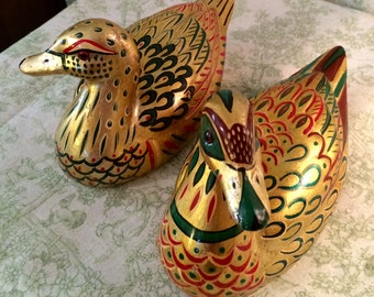 Beautiful , vintage pair of ceramic ducks painted golden with vibrant color accents