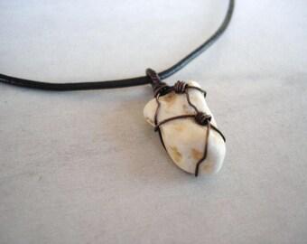 Wire wrapped beach stone pendant necklace in copper wire patina. Men's jewlery