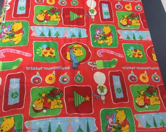 One yard of cotton Disney's Winnie the Pooh winter holiday Christmas fabric.