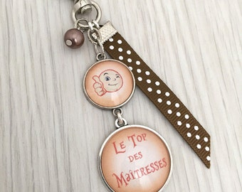 Keychain bag charm message theme has orange top of the centerpieces. REF.37, keychain, bag charm has custom message
