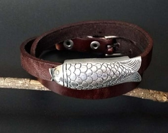 Unique Leather bracelet with silver fish on it, handmade leather bracelet special