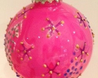 Pink coloured Christmas bauble.