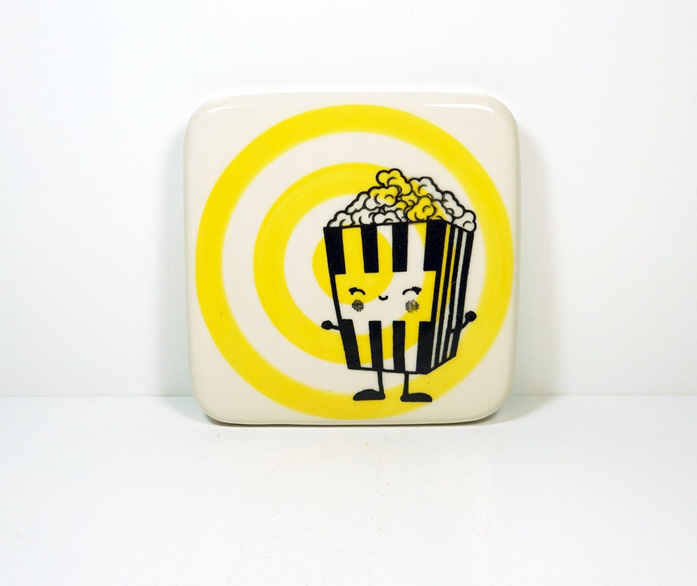 tile with a happy popcorn dude on a yellow bullseye, Made to Order / Pick Your Colour