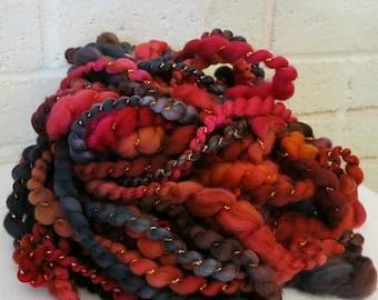 Handspun Art Yarn - Hand Dyed Superwash Merino Wool Yarn - Thick and Thin Yarn - OOAK Yarn - Poppies and Black Tea