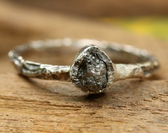 Teardrop dark grey rough diamond ring in bezel setting with sterling silver oxidized hard texture band