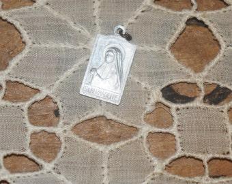 Vintage Saint Bernadette medal with  Our Lady of Lourdes