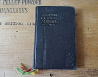 Vintage Saint Joseph Sunday missal and hymnal