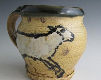 Large  Mug with sheep slip trailed pottery