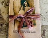1912 Ephemera French Book Pages with collage photo tied in sari ribbon