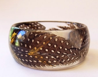 Eco resin bangle with feathers and gold chevrons