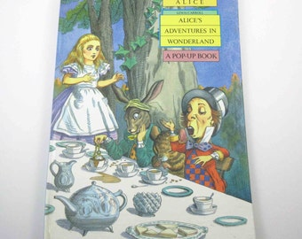 Lewis Carroll Alice's Adventures In Wonderland Illustrated Pop Up Children's Book by John Strejan and James Roger Diaz Dell Publishing