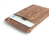 wood grain card sleeve. small brown fabric women cloth credit card holder. cash and business card holder. small gift