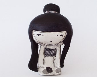 girl with paper koi mini clay doll in a box