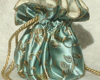 King Midas' Travel Jewelry Bag, Pouch, Travel Organizer in gold on robin's egg blue