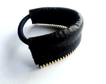 Black leather hair tie with metal zipper detail