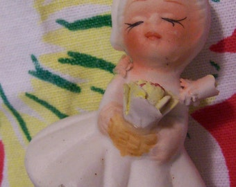 tiny sweet doll figurine