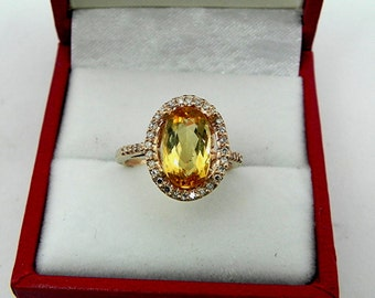 AAAA Golden Orange Imperial Topaz Oval   13x9mm  2.51 Carats   14K Rose gold and diamond Halo ring 0751 y
