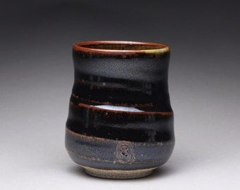 handmade pottery cup, tumbler, yunomi with black brown tenmoku and green celadon glazes