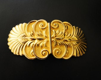 Gatsby vintage 80s gold tone metal , art deco style, large buckle with a butterfly as a centerpiece. Made by Alexis Kirk.