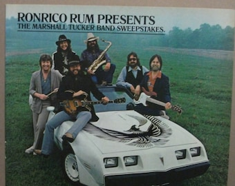 "Movies ... 229  ""The Marshall Tucker Band and Ronrico Rum""   Ad - September  1981"
