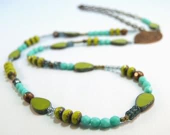 cool tones green blue teal long Czech glass natural brass necklace by CURRICULUM