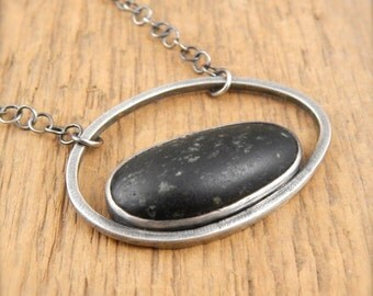 Beach stone necklace, sterling silver, black stone, handmade bezel-set Lake Superior natural beachstone.