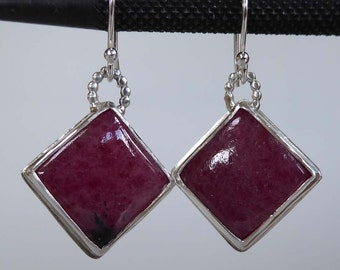 Pink Rhodonite gemstone set in silver earrings