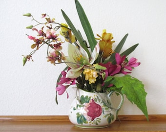 Butterfly Amaryllis Asymetrical Floral Arrangement in Ivory, Rose and Gold with Realistic Orchid Hand Painted Pottery Container