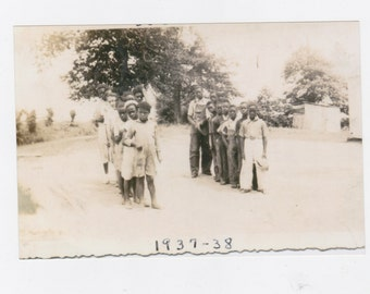 1930s  photograph of a group African Americans students one room school house playing on playground reprint from original photograph