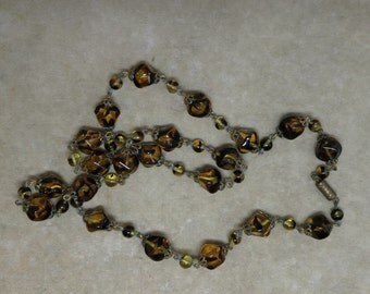 A Vintage Glass Bead Necklace in Amber and Black