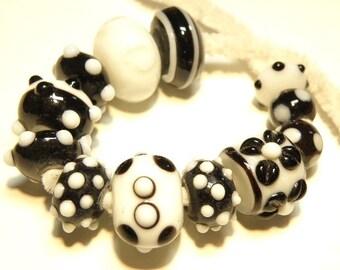 DESTASH - 12 Black, White, and Very Dark Purple Lampwork Glass Orphan Beads  --- Lot 3I