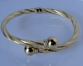 MMI 18Kt Yellow Gold  Spring Hinged Bracelet. 10.5 gm. Made in Italy. RESERVED
