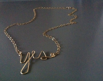 "Gold ""Yes"" wire pendant necklace on chain"